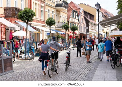 WAREN, GERMANY – JUNE 27, 2017: Tourists in the old town of Waren on the Müritz. The town of Waren is located in the heart of the Mecklenburg Lake District
