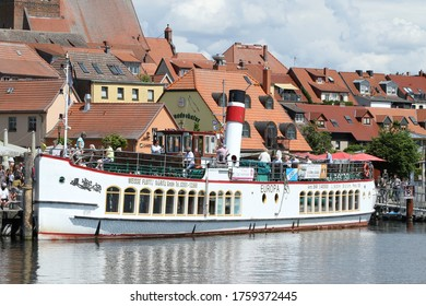 Waren, Germany - May 26th 2020: Steamship Europa, excursion ship of the White Fleet at the pier in Waren (Müritz), Mecklenburg Lake District, Mecklenburg-Vorpommern, Germany