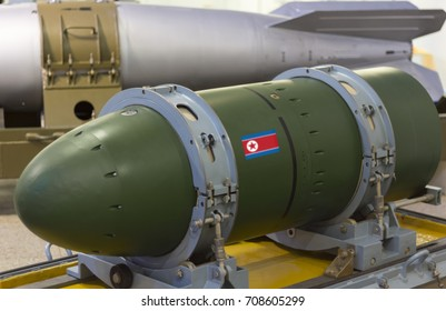A warhead on a transport stand, against a rocket. Weapons of mass destruction. Nuclear weapons, chemical weapons, a bomb.