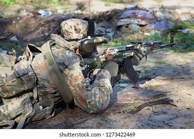 warior on fire position on shooting range,  Kyivska oblast, Ukraine