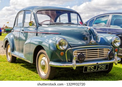 WARKWORH, ENGLAND - APRIL 30, 2018: Vintage 1950 Morris Minor Sedan parked at the lawn in Warkworth, England, UK