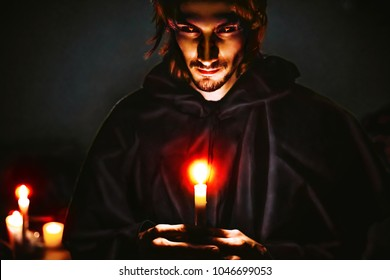 Warlock with a candle in the dark scary look