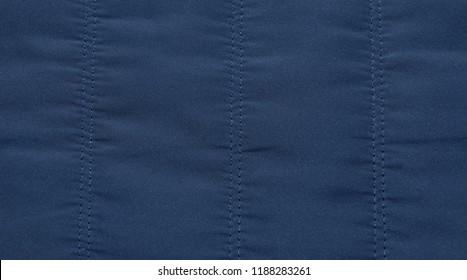 warm blue dark jacket fabric texture background close-up. season winter autumn spring