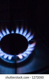 A warm blue flame, metano gas stove