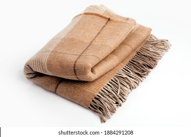 Warm brown alpaca wool or cashmere blanket isolated on white background. Beige, brown squared wool fabric for house design.