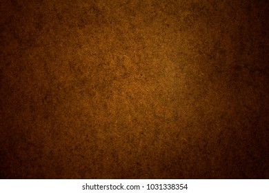 Warm, brown texture for design creativity. Dark, brown background.