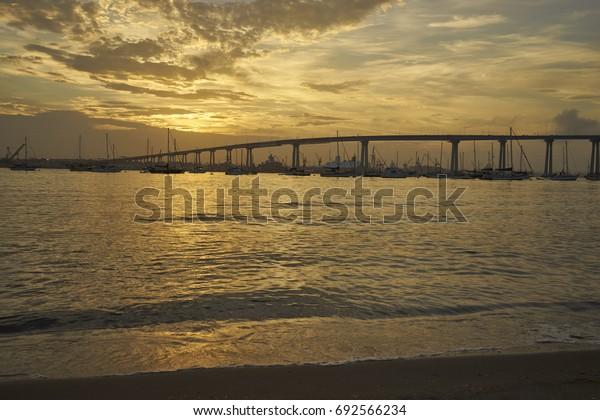 the warm California sun slowly comes up over Coronado Bay, San Diego, California
