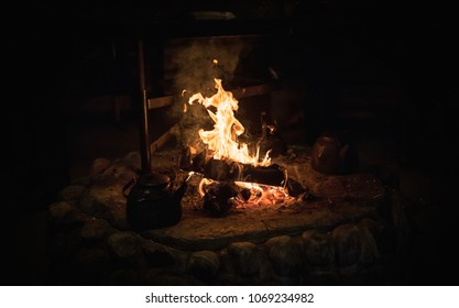 Warm camp fire in Lapland at night