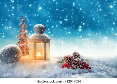 Warm candle light in a snowy winter landscape