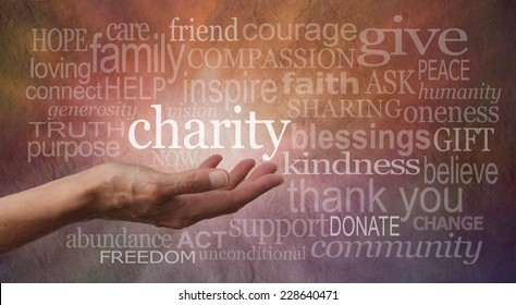 Warm Charity Word Wall  - Woman's outstretched open hand with the word 'charity' in white above palm, surrounded by charity related words on a rustic orange and purple stone effect background