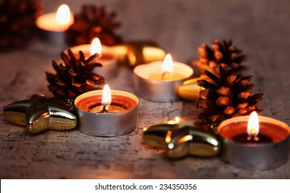 Warm Christmas holiday candles in home interior
