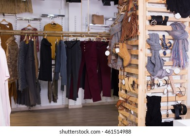 Warm clothing and accessories in modern garment store