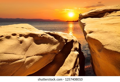 Warm colors of summer sunset by sea, nature background