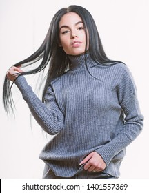 Warm comfortable clothes. Casual style fashion for every day. Female knitwear. Fashionable knitwear. Knitwear concept. Feel warm and comfortable. Woman wear grey textile suit blouse and pants.