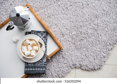 Warm cozy home. Tray and cup of coffee with marshmallows