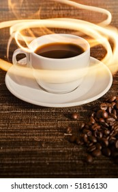 A warm cup of warm coffee on a dark brown textured background.