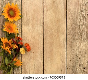 warm fall colors and sunflowers on rustic wood background