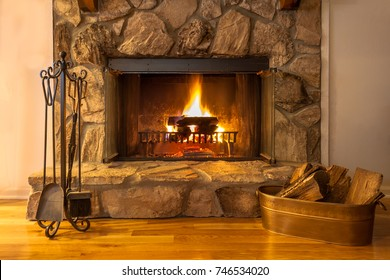 A warm fire in the stone fireplace on a cold night