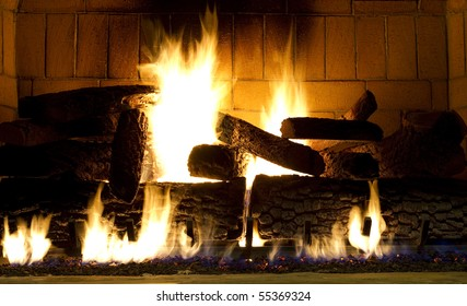 warm fireplace with a fire started