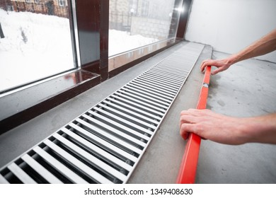 Warm floor. Heating system. Instalaltion of heating convector built into the concrete floor. Repair and renovation in house. Comfort climate at home.