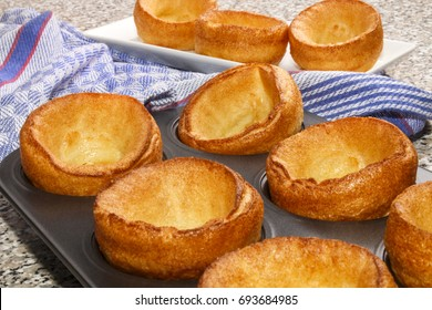 warm and freshly baked yorkshire pudding in a baking tray