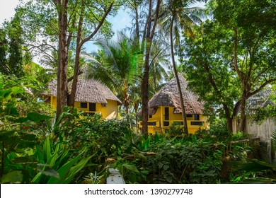Warm Indian Ocean. Fabulous hotel in Mombasa, Kenya, the equator. Bungalows with grass roofs in the rainforest. Beach holiday and photo tourism concept