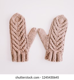 Warm knitted mittens isolated on white background.  Christmas  New Year minimal festive holiday composition. Flatlay, top view, copyspace
