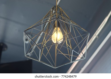 warm light from Light bulb hang on ceiling