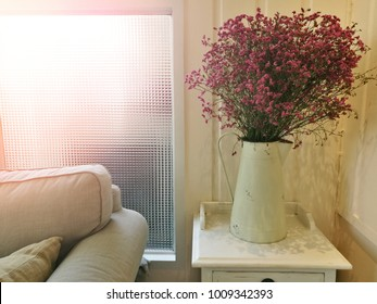 Warm light with cozy dreamy sofa and flower, give country vintage style