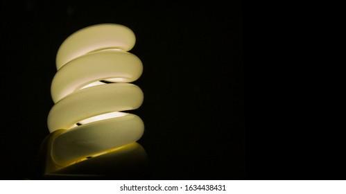 Warm light of energy-saving lamp in the dark