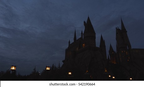 warm light from lamp post and window of hogwarts castle with low light sky from japan travel