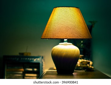 Warm light lampshade yellow lamp on a table