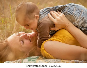 Warm Loving Mother and Son Smiling Close Up