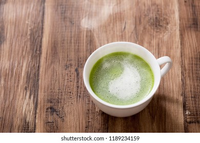 Warm Matcha Latte on the table