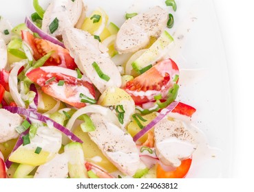 Warm meat salad with vegetables. Isolated on a white background.
