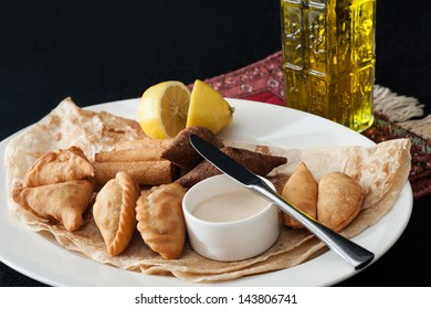 Warm meszzeh traditional Middle eastern food  a platter of kibbeh,spinach fatayer,cheese sambousek,cheese rakakat