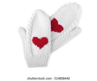 Warm mittens on white background