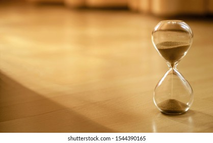 Warm mode of hourglass as time passing concept. Life time passing. Meaning of life