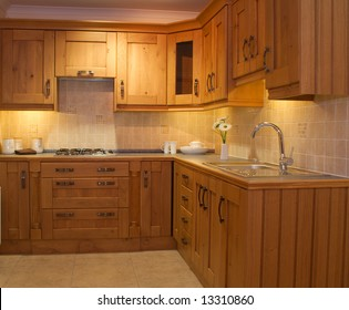 Warm Modern contemporary kitchen design worktop and cupboards in showroom