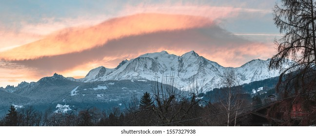 Warm morning clouds over Mont Blanc mountain ridge  (seen from Domancy valley, France). Big resolution, panorama shot. - Shutterstock ID 1557327938