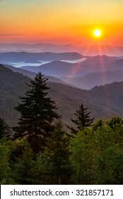 Warm morning light spill out over this beautiful Blue Ridge Mountain scene. Taken along the Blue Ridge Parkway in North Carolina.