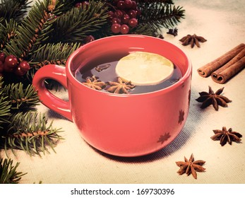 warm mulled wine poured in a red ceramic mug