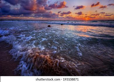 Warm Ocean Beach Sunrise with Three Breaking Waves