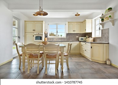 Warm retro styled kitchen and dinning room with panoramic window