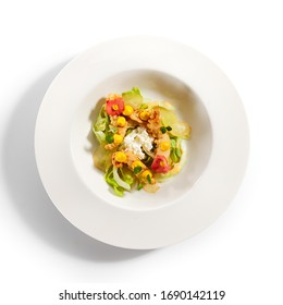 Warm salad with crispy langoustines. Delicious served dish with roasted seafood. Tasty food in white plate decorated with flowers and sauce. Haute cuisine, sicilian recipe. Restaurant menu - Shutterstock ID 1690142119