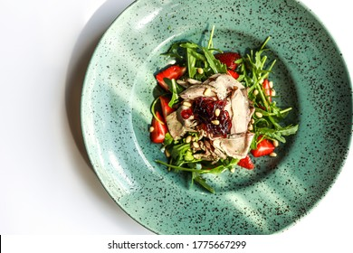 Warm salad with meat and strawberries on white background. Topview of roasted meat salat with arugula and pine nuts - Shutterstock ID 1775667299