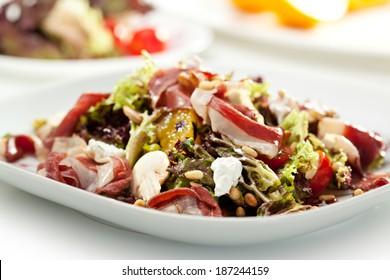 Warm Salad with Parma Ham, Mushrooms, Orange and Pine Nuts