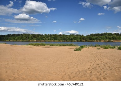 Warm sand on the banks of the river Vyatka. The beauty of Russian nature.