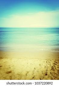 Warm sea and sand beach. Dreamy retro style image.