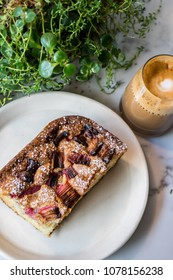 Warm Slice of Sweet Strawberry Rhubarb Cake Bread with an Espresso Latte